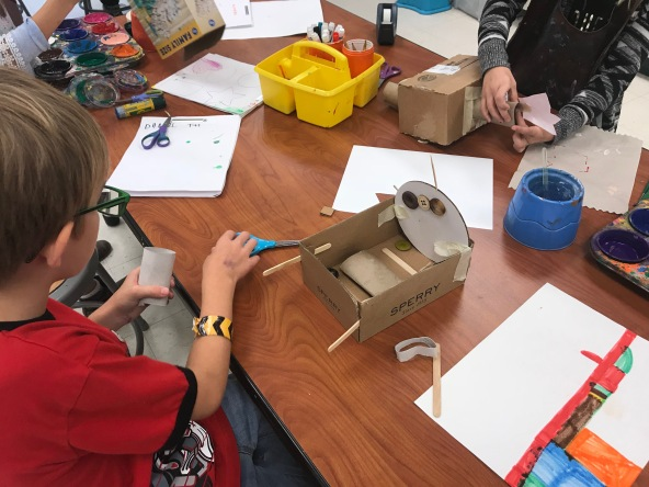 students creating sculptures